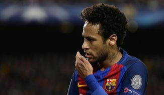 Barcelona's Neymar gestures during the Champions League quarterfinal second leg soccer match between Barcelona and Juventus at Camp Nou stadium in Barcelona, Spain, Wednesday, April 19, 2017. (AP Photo/Emilio Morenatti)