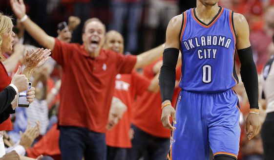 Oklahoma City Thunder guard Russell Westbrook walks down the court in the final seconds of Game 2 of the team's NBA basketball first-round playoff series against the Houston Rockets, Wednesday, April 19, 2017, in Houston. Houston won 115-111. (AP Photo/Eric Christian Smith)