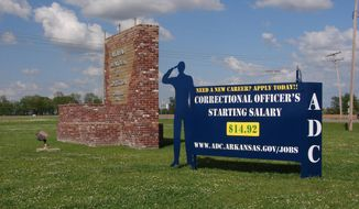 A recruiting sign for the Arkansas Department of Correction greets visitors to the Cummins Unit prison near Varner, Arkansas, which was scheduled to hold executions Thursday, April 20, 2017. If any inmate dies by lethal injection, it would be the state's first execution since 2005. (AP Photo/Kelly P. Kissel)