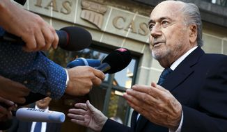 FILE - In this Thursday Aug. 25, 2016 file photo, former FIFA President Sepp Blatter arrives at the International Court of Arbitration for Sport, CAS, for his appeal on a six-year ban on football related activities in Lausanne, Switzerland.  Sepp Blatter said on Friday April 21, 2017, that he has met with U.S. Department of Justice officials and is not a suspect in their investigation of corruption linked to FIFA. (Valentin Flauraud/Keystone via AP, File)