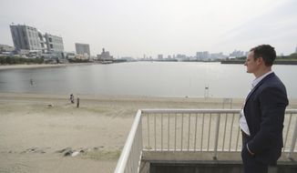 "In this Thursday, April 20, 2017 photo, Andrew Baker, Games Director of the Canadian Olympic Committee, looks at Odaiba Seaside Park, the venue of the Tokyo 2020 Summer Olympic and Paralympic Games, during an interview with The Associated Press in Tokyo. With just over three years to go, National Olympic Committees are already visiting Tokyo to survey the city's Olympic plans and ensure their athletes will compete under the best possible conditions at the 2020 Games. ""There is a high level of confidence in what Tokyo 2020 will deliver,"" said Baker. ""You expect a high level of organization and I would say from what we've seen with the planning so far they are living up to that reputation."" (AP Photo/Eugene Hoshiko)"