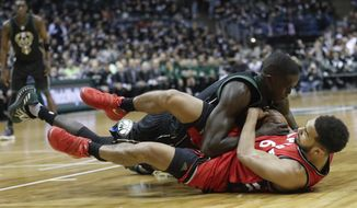 Milwaukee Bucks' Thon Maker and Toronto Raptors' Cory Joseph dive after a loose ball during the second half of game 3 of their NBA first-round playoff series basketball game Thursday, April 20, 2017, in Milwaukee. The Bucks won 106-77. (AP Photo/Morry Gash)