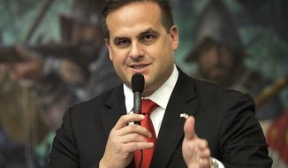 In this March 9, 2012, file photo Republican state senator Frank Artiles, R-Miami, asks a questions about a pip insurance bill during house session in Tallahassee, Fla. Artiles, who used a racial slur and vulgar language in a conversation with two African-American colleagues, submitted a resignation letter to the Senate president's office on Friday, April 21, 2017.   (AP Photo/Steve Cannon, File)