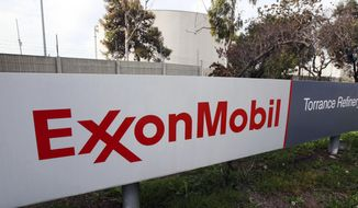 FILE - This Jan. 30, 2012, file photo, shows the sign for the Exxon Mobil Torrance Refinery in Torrance, Calif. On Friday, April 21, 2017, the Trump administration denied a request from Exxon Mobil to waive U.S. sanctions against Russia and allow it to resume oil drilling around the Black Sea. (AP Photo/Reed Saxon, File)