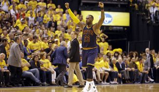 Cleveland Cavaliers forward LeBron James (23) celebrates a basket during the second half against the Indiana Pacers in Game 3 of a first-round NBA basketball playoff series, Thursday, April 20, 2017, in Indianapolis. The Cavaliers defeated the Pacers 119-114. (AP Photo/Michael Conroy)