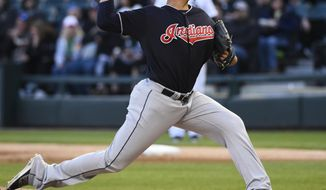 Cleveland Indians starting pitcher Carlos Carrasco (59) delivers against the Chicago White Sox during the first inning of a baseball game in Chicago Saturday, April 22, 2017. (AP Photo/Matt Marton)