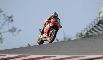 Marc Marquez (93), of Spain, speeds out of a turn during a warm up session for the Grand Prix of the Americas MotoGP motorcycle race, Sunday, April 23, 2017, in Austin, Texas. Marquez will start from pole position for the fifth successive year at the Grand Prix of the Americas and is looking to take his fifth successive win at the circuit. (AP Photo/Eric Gay)