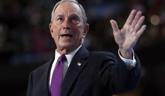 FILE - In this Wednesday, July 27, 2016, file photo, former New York City Mayor Michael Bloomberg waves after speaking to delegates during the third day session of the Democratic National Convention in Philadelphia. The former New York City mayor addressed his intensifying focus on climate change on Saturday, April 22, 2017, in an email interview with The Associated Press. Bloomberg said he wants to help save an international agreement to reduce carbon emissions. (AP Photo/Carolyn Kaster, File)