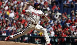 Philadelphia Phillies' Zach Eflin pitches during the third inning of a baseball game against the Atlanta Braves, Sunday, April 23, 2017, in Philadelphia. (AP Photo/Matt Slocum)