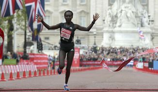 Kenya's Mary Keitany crosses the finish line to win the London Marathon in London on, Sunday, April 23, 2017. (AP Photo/Tim Ireland)