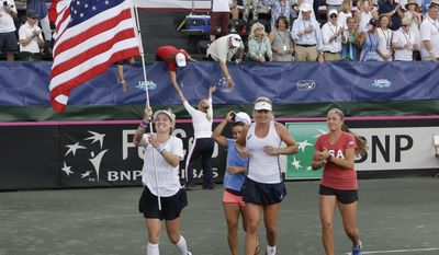 United States Fed Cup team, from left, Bethanie Mattek-Sands, Shelby Rogers, CoCo Vandeweghe and Lauren Davis runs a lap around the court after they defeated the Czech Republic in semifinal tennis match, Sunday, April 23, 2017, in Wesley Chapel, Fla. (AP Photo/John Raoux)
