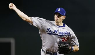 Los Angeles Dodgers' Brandon McCarthy throws a pitch against the Arizona Diamondbacks during the first inning of a baseball game Sunday, April 23, 2017, in Phoenix. (AP Photo/Ross D. Franklin)