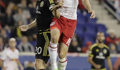 Columbus Crew midfielder Will Trapp, left, and New York Red Bulls midfielder Sacha Kljestan compete for the ball during the first half of an MLS soccer match, Saturday, April 22, 2017, in Harrison, N.J. (AP Photo/Julio Cortez)