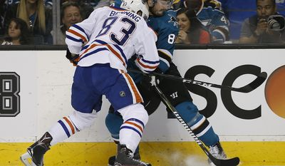 San Jose Sharks left wing Mikkel Boedker (89) battles for the puck against Edmonton Oilers defenseman Matthew Benning (83) during the first period in Game 6 of a first-round NHL hockey playoff series Saturday, April 22, 2017, in San Jose, Calif. (AP Photo/Tony Avelar)