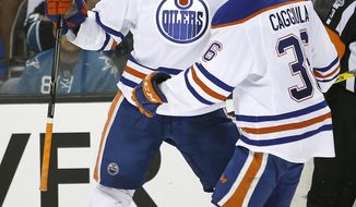 Edmonton Oilers center Leon Draisaitl (29) celebrates with teammate Drake Caggiula (36) after scoring a goal against the San Jose Sharks during the second period in Game 6 of a first-round NHL hockey playoff series Saturday, April 22, 2017, in San Jose, Calif. (AP Photo/Tony Avelar)