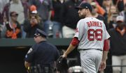 Boston Red Sox pitcher Matt Barnes walks off the field after being ejected for throwing at Manny Machado during the eighth inning of a baseball game, Sunday, April 23, 2017 in Baltimore. The Red Sox won 6-2. (AP Photo/Gail Burton)