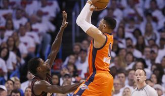 Oklahoma City Thunder guard Russell Westbrook (0) shoots over Houston Rockets guard Patrick Beverley (2) in the first quarter of Game 4 of a first-round NBA basketball playoff series in Oklahoma City, Sunday, April 23, 2017. (AP Photo/Sue Ogrocki)