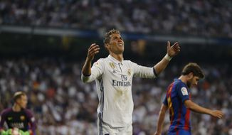Real Madrid's Cristiano Ronaldo gestures after missing a scoring chance during a Spanish La Liga soccer match between Real Madrid and Barcelona, dubbed 'el clasico', at the Santiago Bernabeu stadium in Madrid, Spain, Sunday, April 23, 2017. (AP Photo/Francisco Seco)