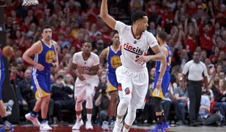 Portland Trail Blazers guard CJ McCollum reacts after making a three-point basket against the Golden State Warriors during the first half of Game 3 of an NBA basketball first-round playoff series Saturday, April 22, 2017, in Portland, Ore. (AP Photo/Craig Mitchelldyer)