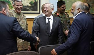 "Defense Secretary James Mattis (center) met Monday with Army Gen. John Nicholson, the top U.S. commander in Afghanistan (second left), Afghan security director Mohammad Masoom Stanekzai (right) and other members of the Afghan delegation at headquarters in Kabul. Mr. Mattis said he was ""under no illusions"" about the multitude of threats to the country's security. (Associated Press)"