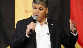 Fox News Channel's Sean Hannity speaks during a campaign rally for Republican presidential candidate, Sen. Ted Cruz, R-Texas, in Phoenix, March 18, 2016. (AP Photo/Rick Scuteri) ** FILE **