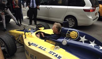 Indiana Pacers president Larry Bird sits in an Indy car in New York, Monday, April 24, 2017. Bird drove four blocks down Fifth Avenue in the car to deliver the basketball team's bid to host the 2021 game to NBA Commissioner Adam Silver, fitting his 6-foot-9 frame into a car usually driven by much shorter people. (AP Photo/Brian Mahoney)