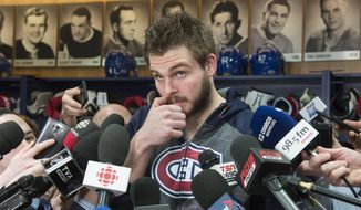 Montreal Canadiens' Alex Galchenyuk ponders a question as he meets with reporters, Monday, April 24, 2017 in Brossard, Quebec, Monday, April 24, 2017. The Canadiens were eliminated by the New York Rangers in the first round of the NHL hockey playoffs. (Paul Chiasson/The Canadian Press via AP)