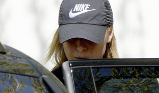 Russian tennis player Maria Sharapova gets into a car in Stuttgart, Germany, Monday, April 24, 2017. After the end of her 15-month doping suspension Sharapova will play at the Porsche Grand Prix tennis tournament in Stuttgart this week. (Bernd Weissbrod/dpa via AP)