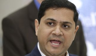 FILE - In this March 30, 2016 file photo, Illinois secretary of the Department of Innovation and Technology Hardik Bhatt speaks to reporters in Springfield, Ill. Bhatt has spent $208,000 in tax dollars for two professional memberships despite the states budget crisis. (AP Photo/Seth Perlman File)