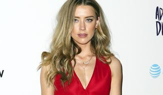 "FILE - In this April 12, 2016 file photo, Amber Heard attends the LA Premiere of ""The Adderall Diaries"" in Los Angeles. Heard was spotted spending time with billionaire Elon Musk in Australia on April 24, 2017. (Photo by John Salangsang/Invision/AP, File)"