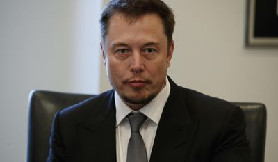 FILE - In this Dec. 14, 2016, file photo, Tesla CEO Elon Musk listens as President-elect Donald Trump speaks during a meeting with technology industry leaders at Trump Tower in New York., Musk was spotted spending time with actress Amber Heard in Australia on April 24, 2017, (AP Photo/Evan Vucci, File)