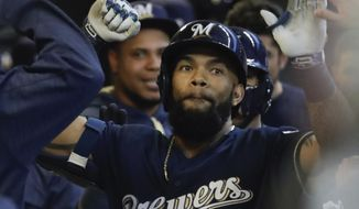 Milwaukee Brewers' Eric Thames celebrates his two-run home run during the second inning of a baseball game against the Cincinnati Reds Monday, April 24, 2017, in Milwaukee. (AP Photo/Morry Gash)