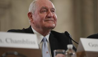 FILE - In this March 23, 2017 file photo, Agriculture Secretary-designate, former Georgia Gov. Sonny Perdue arrives to testify on Capitol Hill in Washington to testify at his confirmation hearing before the Senate Agriculture, Nutrition and Forestry Committee. After months of delays, the Senate is expected to confirm Agriculture Secretary nominee Sonny Perdue on Monday, April 24, 2017, with bipartisan support. (AP Photo/Pablo Martinez Monsivais, File)