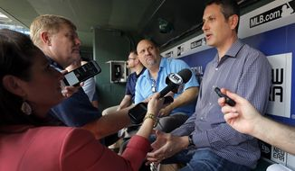 Thad Levine, Senior Vice President, General Manager of the Minnesota Twins talks with reporters in the visitors dugout before a baseball game against the Texas Rangers in Arlington, Texas, Monday April 24, 2017. (AP Photo/Tony Gutierrez)