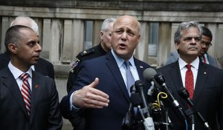 New Orleans, La. Mayor Mitch Landrieu, center, flanked by Providence, R.I. Mayor Jorge Elorza, left, and Austin, Texas Mayor Steve Adler, accompanied by members of the U.S. Conference of Mayors leadership, speaks to reporters outside the Justice Department in Washington, Tuesday, April 25, 2017, following a meeting with Attorney General Jeff Sessions. (AP Photo/Manuel Balce Ceneta)