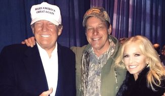 Legendary rock musician Ted Nugent and his wife, Shemane, pose with President Donald Trump. (Twitter, Ted Nugent) ** FILE **