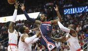 Atlanta Hawks defenders Dennis Schroder, from left, Dwight Howard, and Paul Millsap force Washington Wizards John Wall to pass off under the basket in an NBA playoff basketball game , in Atlanta on Monday, April 24, 2017. Atlanta won 111-101 to even the best-of seven series at 2-2. (Curtis Compton/Atlanta Journal-Constitution via AP)
