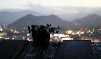 The city of Kabul can be seen at sundown from the rear deck of a U.S. Army helicopter as it departs Resolute Support headquarters with U.S. Defense Secretary James Mattis aboard in Kabul, Afghanistan, Monday, April 24, 2017. (Jonathan Ernst/Pool Photo via AP)