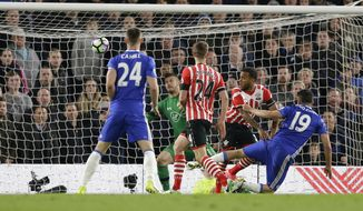 Chelsea's Diego Costa, right, scores a goal during the English Premier League soccer match between Chelsea and Southampton at Stamford Bridge stadium in London, Tuesday, April 25, 2017. (AP Photo/Alastair Grant)