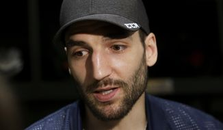 Boston Bruins center Patrice Bergeron takes questions from reporters in the NHL hockey team's locker room at their training facility, Tuesday, April 25, 2017, in Boston. The Bruins made it back to the playoffs for the first time in three seasons before being eliminated in game six of the first round by the Ottawa Senators. (AP Photo/Steven Senne)