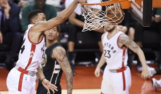 Toronto Raptors guard Norman Powell (24) dunks the ball against the Milwaukee Bucks during the second half of game five of an NBA first-round playoff series basketball game in Toronto on Monday, April 24, 2017. (Nathan Denette/The Canadian Press via AP)
