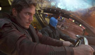 """This image released by Disney-Marvel, Chris Pratt, left, and Michael Rooker appear in a scene from, Guardians Of The Galaxy Vol. 2."""" (Marvel Studios/Disney via AP)"""