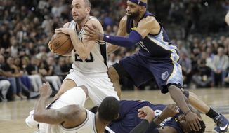 San Antonio Spurs guard Manu Ginobili (20) grabs a loose ball in front of Memphis Grizzlies guard Vince Carter (15) during the first half of Game 5 in a first-round NBA basketball playoff series, Tuesday, April 25, 2017, in San Antonio. (AP Photo/Eric Gay)