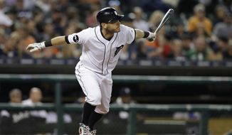 Detroit Tigers' Ian Kinsler watches his two-run single to center during the fifth inning of a baseball game against the Seattle Mariners, Tuesday, April 25, 2017, in Detroit. (AP Photo/Carlos Osorio)