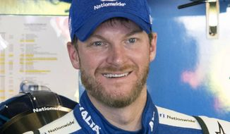 FILE -  In this March 3, 2017, file photo, Dale Earnhardt Jr. smiles in the garage during practice for the NASCAR Monster Energy Cup auto race at Atlanta Motor Speedway in Hampton, Ga. Hendrick Motorsports says Dale Earnhardt Jr. will retire at the end of this season. (AP Photo/John Amis, File)