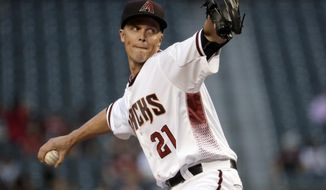 Arizona Diamondbacks starting pitcher Zack Greinke (21) throws against the San Diego Padres during the first inning of a baseball game, Monday, April 24, 2017, in Phoenix. (AP Photo/Matt York)
