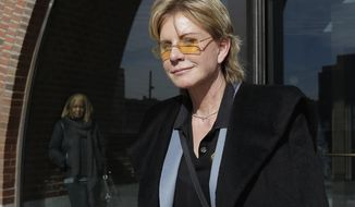 FILE - In a Feb. 7, 2013, file photo, author Patricia Cornwell leaves federal court in Boston after she took the stand in her lawsuit against her former financial management company. Media outlets report that Cornwell visited the department Monday, April 24, 2017, and paid the costs for an entire weeklong course on gunshot restoration, worth an estimated $20,000. The purpose of the donation is philanthropic, but Cornwell said she also intends to observe the course as part of research for her next novel. (AP Photo/Steven Senne, File)