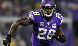 FILE - In this Sept. 18, 2016, file photo, Minnesota Vikings running back Adrian Peterson carries the ball during the first half of an NFL football game against the Green Bay Packers, in Minneapolis.  Free-agent running back Adrian Peterson has reportedly agreed to a two-year contract with the New Orleans Saints. The Saints have not announced a deal, but Peterson tells ESPN in a statement that he's agreed to play in New Orleans. (AP Photo/Andy Clayton-King, File)