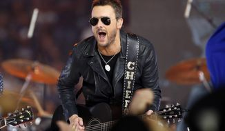 FILE - In this Nov. 24, 2016, file photo, country music singer Eric Church performs at halftime during an NFL football game between the Washington Redskins and Dallas Cowboys in Arlington, Texas. Church is one of many musicians using new technology, including 360-degree cameras, virtual reality musical experiences and vertical videos, to reach the smart phone generation of music fans who are discovering new music on their phones and tablets. (AP Photo/Ron Jenkins, File)