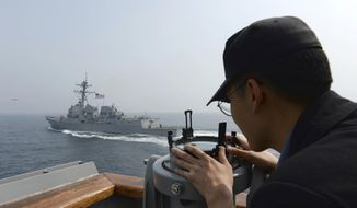 In this photo provided by South Korean Defense Ministry, a South Korean navy sailor watches the destroyer USS Wayne E. Meyer during a joint exercises between the United States and South Korea in South Korea's West Sea Tuesday, April 25, 2017. South Korea's military said Tuesday that North Korea held major live-fire drills in an area around its eastern coastal town of Wonsan as it marked the anniversary of the founding of its military. (South Korean Defense Ministry via AP)